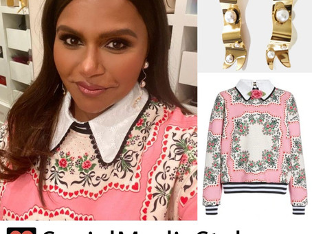 Mindy Kaling's floral and heart print sweatshirt and pearl ribbon earrings