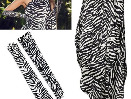 Miley Cyrus' zebra print gloves and one shoulder dress