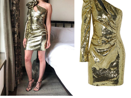 Alison Brie's gold sequin one shoulder dress from Late Night with Seth Meyers