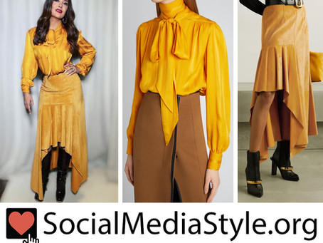 Salma Hayek's yellow silk blouse and high low suede skirt