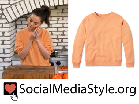 Selena Gomez's orange sweatshirt from Selena + Chef