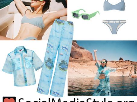Zoey Deutch's green rectangular sunglasses, blue bikini, and tropical print sheer top and pants