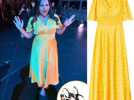 Mindy Kaling's yellow floral print dress dress and red, white, and black sandals