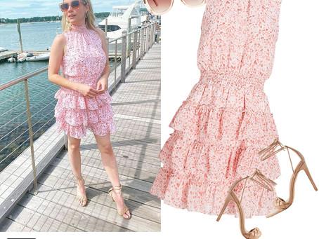 Emma Roberts' ruffled pink print dress, cat eye sunglasses, and tan ankle wrap sandals