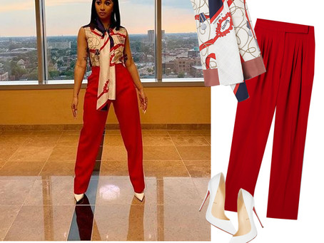 Cardi B's print pussy-bow top, red pants, and white pumps