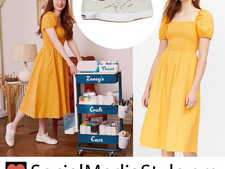 Zooey Deschanel's yellow puff sleeve dress and canvas sneakers