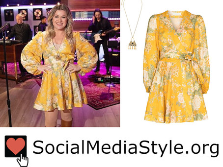 Kelly Clarkson's triangle necklace and yellow floral print dress from The Kelly Clarkson Show