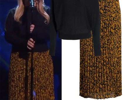 Kelly Clarkson's black snap detail sweater and printed maxi skirt from The Kelly Clarkson Show