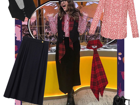 Drew Barrymore's heart print shirt, tartan scarf, and black vest, skirt, and shoes