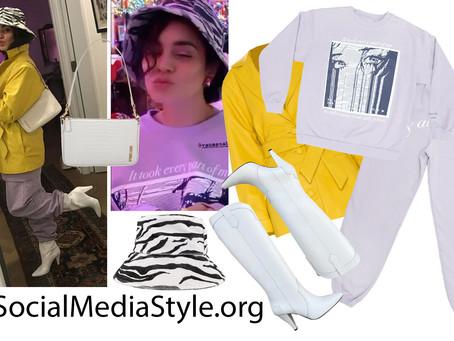 Vanessa Hudgens' zebra bucket hat, yellow leather jacket, sweatsuit, white bag, and white boots