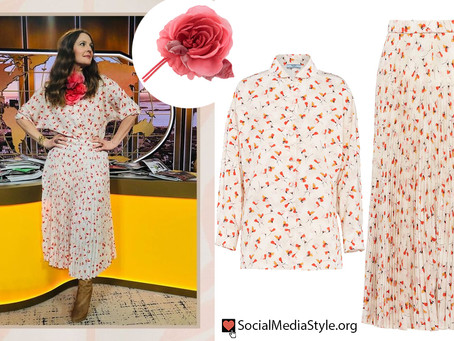 Drew Barrymore's flower brooch and floral print top and skirt from The Drew Barrymore Show