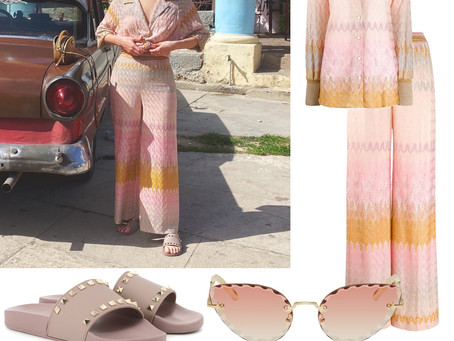 Kacey Musgraves' pink cateye sunglasses, print shirt and pants, and studded slide sandals