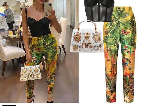 Sofia Vergara's Dolce & Gabbana black corset, heart embroidered white bag, and jungle print pants