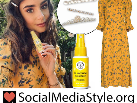 Lily Collins' pearl barrette, yellow floral print dress, & Beekeeper's Naturals immune support spray