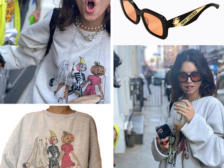 Vanessa Hudgens' Halloween sweatshirt and orange lens sunglasses