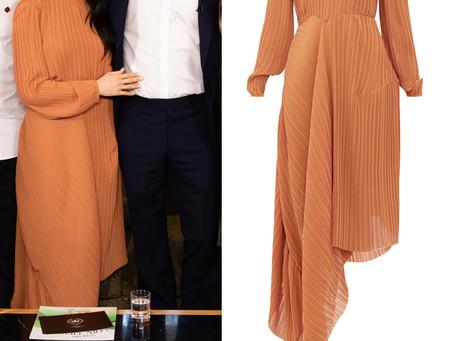 Meghan Markle's brown asymmetric pleated dress