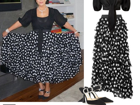 Kris Jenner's black knotted top, polka dot skirt, and crystal buckle mules