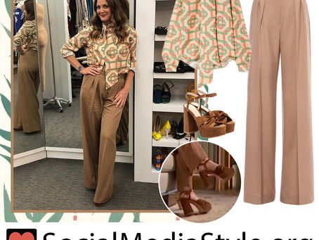 Drew Barrymore's print blouse, brown pants, and brown platform sandals from The Drew Barrymore Show