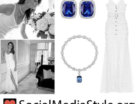 Penelope Cruz's sapphire earrings and necklace and white lace dress