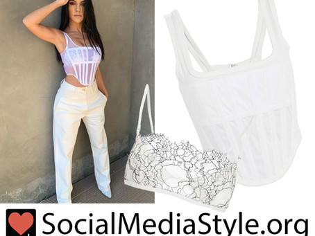 Kourtney Kardashian's white corset top and lace bra