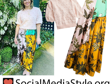 Elizabeth Banks' pink pom pom sweater and mixed floral print skirt