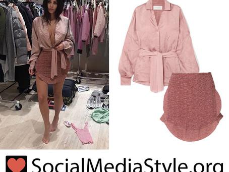 Kim Kardashian's pink blouse and metallic skirt