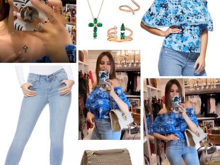 Sofia Vergara's emerald jewelry, off-the-shoulder blue floral print top, tan bag, and skinny jeans