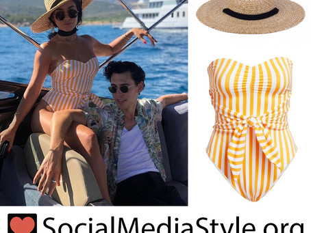 Vanessa Hudgens' straw hat and striped swimsuit