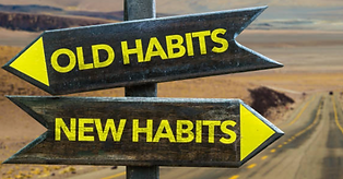 Sign of arrows saying old habits and new habits