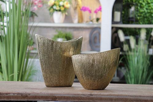Potes de cerámica dorado