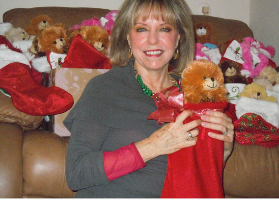 Sallie Brown holding one of the stockings