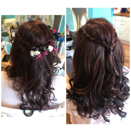 Hair extensions were used to give fullness to this half up half down style