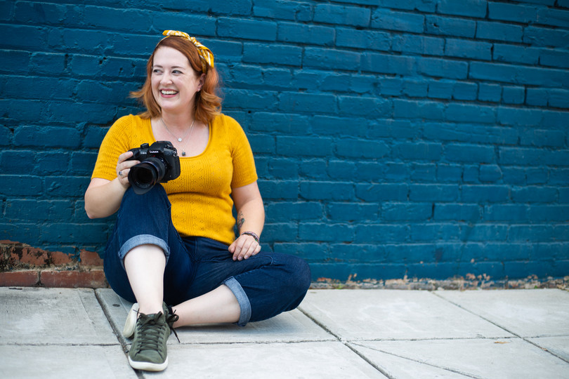 Portrait of videographer holding her camera
