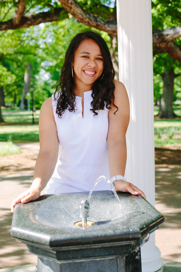 Old well college senior portrait in Chapel Hill, NC at UNC Chapel Hill