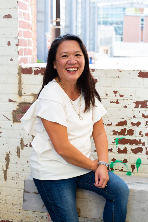 Portrait of smiling Asian woman in a white blouse in Raleigh, North Carolina