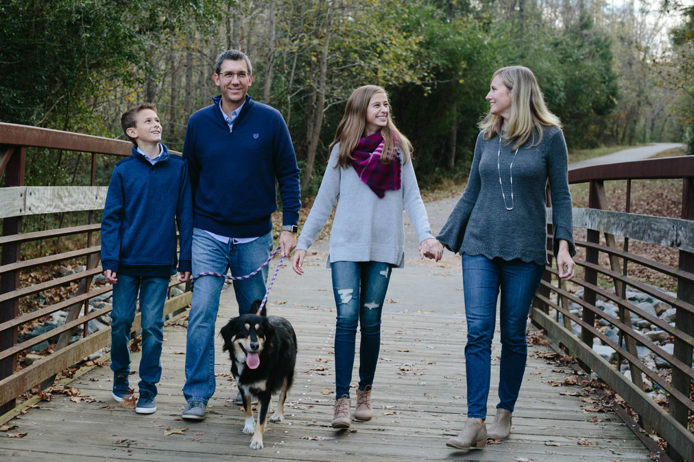Family portraits on a bridge with pet in Wake Forest, NC