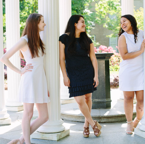 Senior portraits of three young women at the Old Well at UNC-Chapel Hill in Chapel Hill, North Carolina