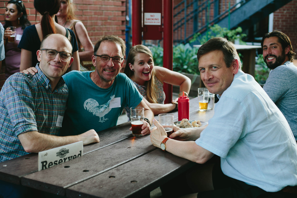 Networking event photo of people at a picnic table smiling in Durham, NC