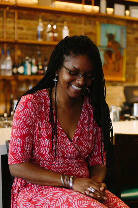 Portrait of black woman in a Red dress in Beyu Cafe in Durham North Carolina