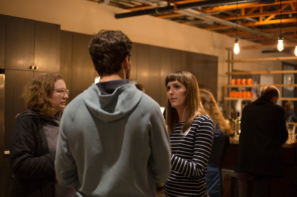 People talking at a networking event in Raleigh, NC