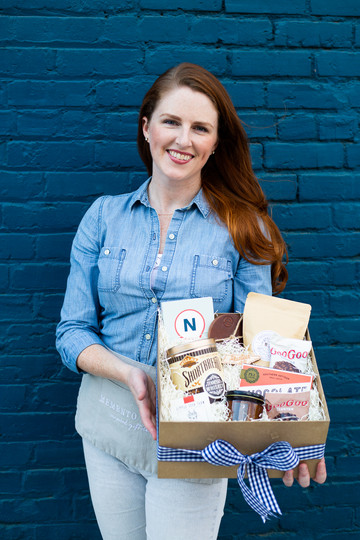 Brand photography of a woman holding custom gifting in Raleigh, NC