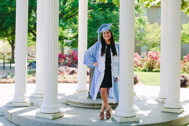 College Senior portrait at the Old well at the University of North Carolina - Chapel Hill with College Senior in Cap and Gown