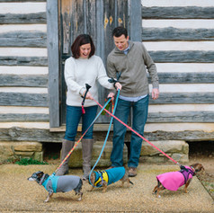 Family portrait of husband and wife and three little dogs in Carroll Joyner Park in Wake Forrest, North Carolina