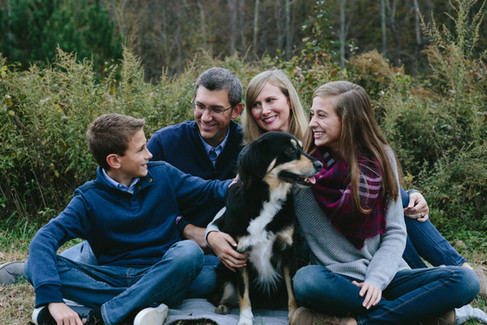 Family portraits of Mom, Dad, son, and daughter with their dog in Wake Forest, NC