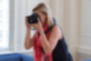 Photo of Christina Marie Noel taking portraits with her Canon Camera at HQ Raleigh in downtown Raleigh, NC
