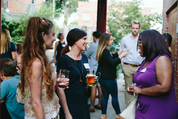 Photo of people networking at a brand event in Durham, NC