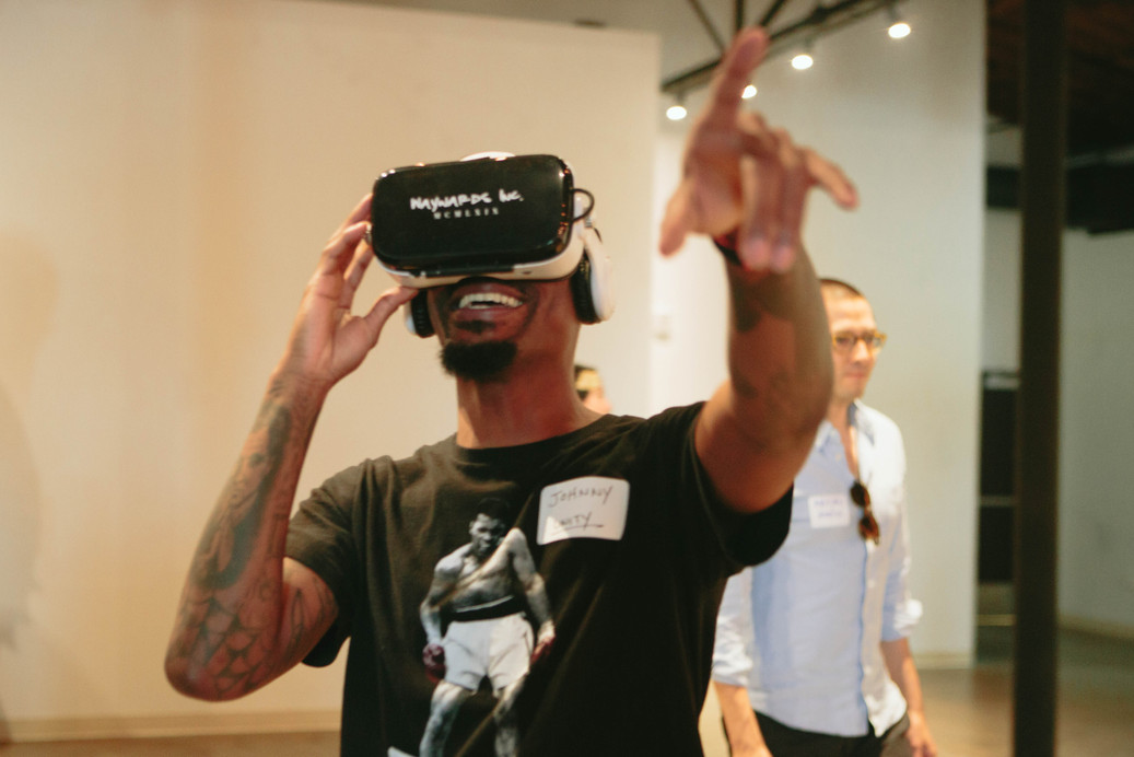 Corporate event photography of a black man wearing a VR headset in Raleigh, NC
