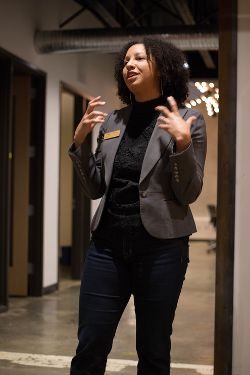 Portrait of woman presenting at a networking event in Raleigh, North Carolina