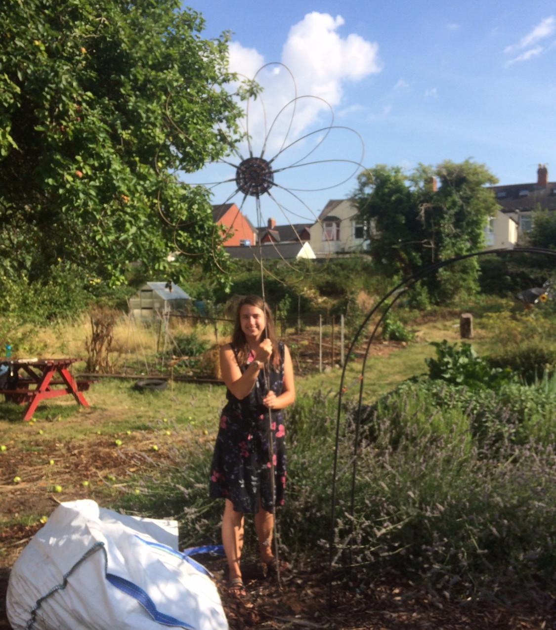 Imogen with her sunflower