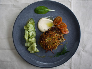 Potato and dill rosti with roast garlic aioli, pickled cucumber and confit tomatoes by Manuel